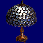 Desktop lamp with blue pearls
